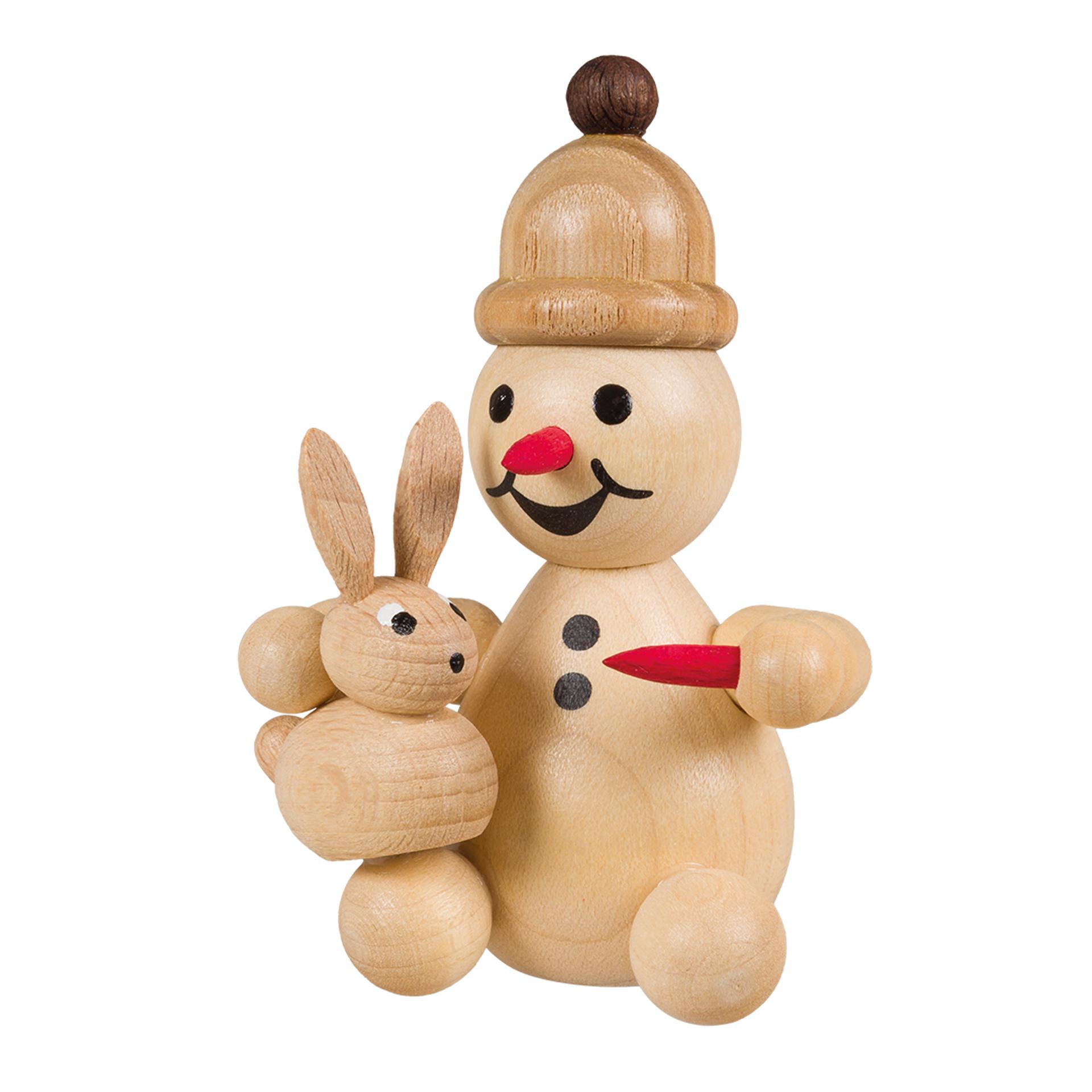 Schneemann Junior mit Hase auf Schoß, sitzend