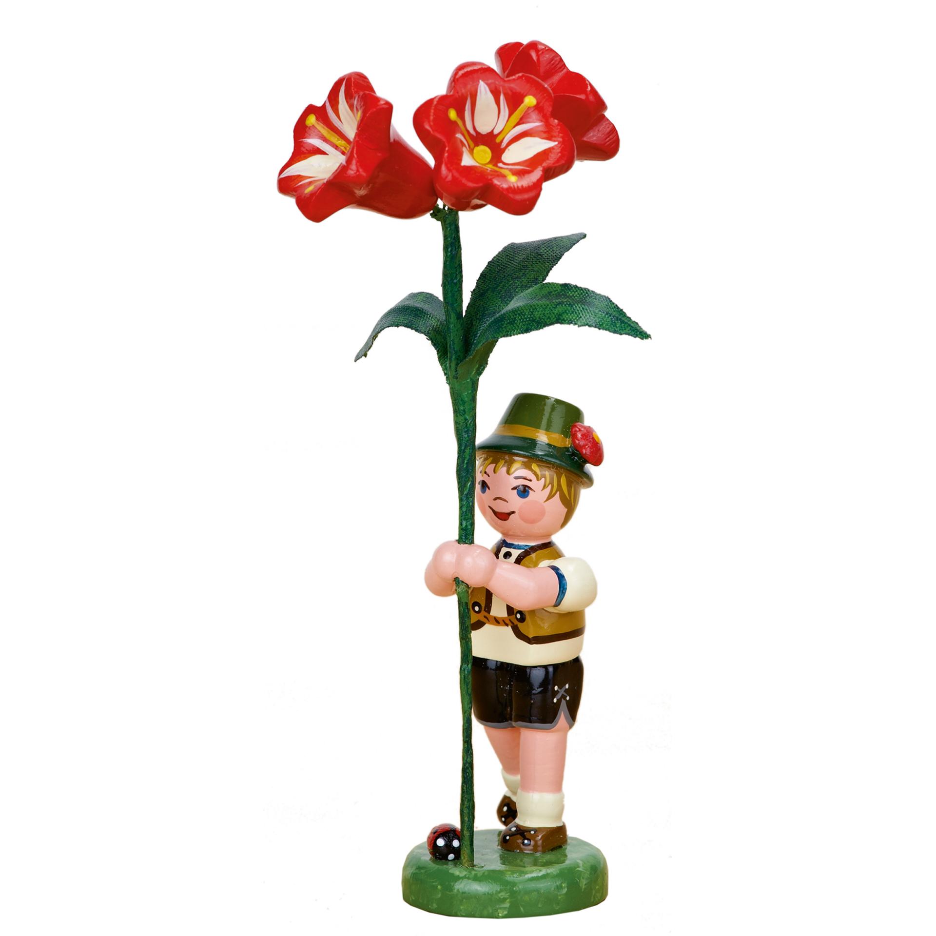 Blumenkind Junge mit Amaryllis